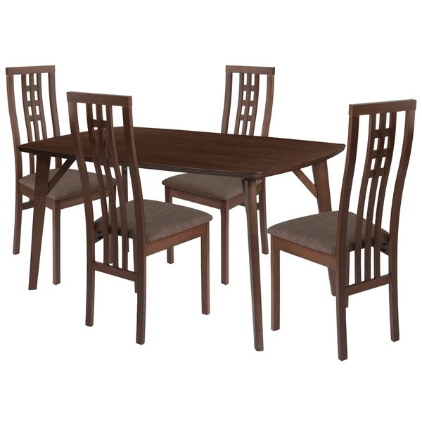 Make any meal special by bringing the family together. The table features a large, smooth surface for everyone to sit around and eat. This dining table set comes complete with four chairs. Chair features a curved, artistic cutout back.      This product will ship to you in multiple boxes.        Assembly Required
