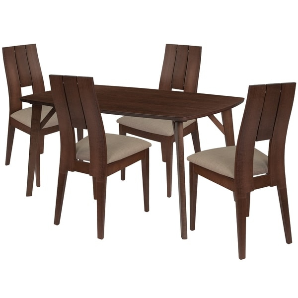Make any meal special by bringing the family together. The table features a large, smooth surface for everyone to sit around and eat. This dining table set comes complete with four chairs. Chair features a curved, double slit, cutout back.      This product will ship to you in multiple boxes.        Assembly Required