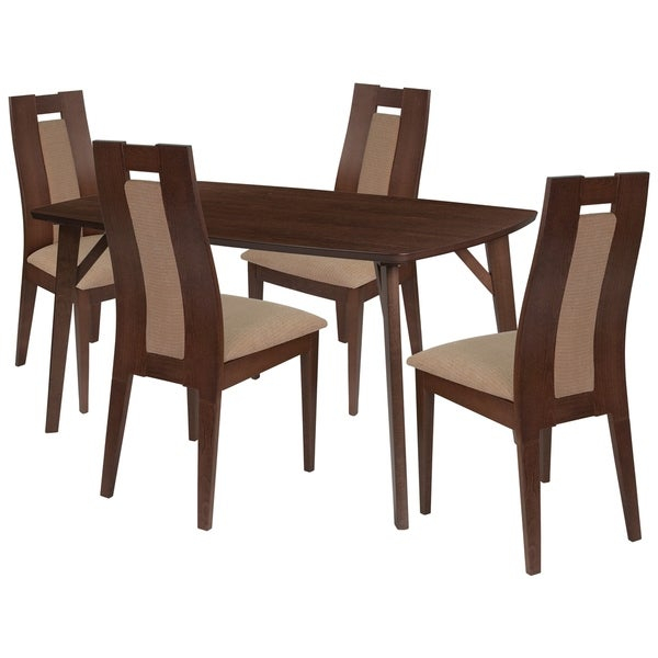 Make any meal special by bringing the family together. The table features a large, smooth surface for everyone to sit around and eat. This dining table set comes complete with four chairs. Chair features a padded back with wood slats on either side.      This product will ship to you in multiple boxes.        Assembly Required