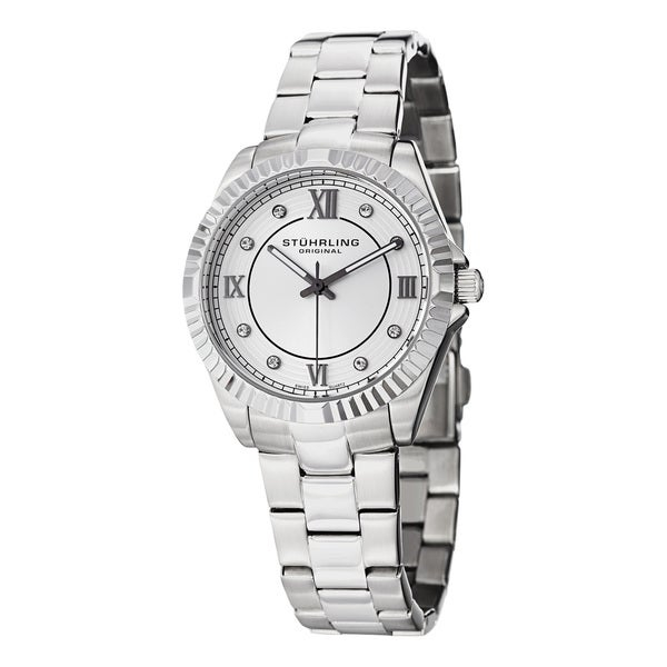 The Lady Nautic features an elegant round case decorated with Swarovski crystals in a dazzling configuration. It is equipped with a Swiss Quartz Movement and a seamlessly integrated steel link bracelet.    Case: 316L Surgical Grade Stainless Steel Silver  Caseback: Stainless Steel, Screw down  Bezel: Ribbed Bezel  Dial: Burshed Finish Inner Dial with Concentric Circles Throughout Outer Dial   Hands: Stick-Style Hands with Luminous Fill   Markers: Individually Applied Arabic Numerals at -3,6,9,12; and Swarovski Crystal Markers at All Other Points  Strap:Bracelet Silver Stainless Steel Link  Clasp: Push Button Deployant  Crystal: Krysterna  Crown: Push/Pull Fluted Crown with Stuhrling S Logo  Movement: Swiss Quartz  Water resistance: 10 ATM/100 meters/330 feet  Case measurements: 35.0mm wide x 35.0mm long x 8.84mm thick  Strap measurements: 18.0mm wide x 7.0 inches long  Model: LW399LS22112O    Women's watch bands can be sized to fit 6.5-inch to 7.5-inch wrists.   Click here to view our  Watch Sizing Guide .      All measurements are approximate and may vary slightly from the listed dimensions.